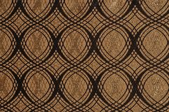 Brown colored patterned fabric texture. Details of the texture and weaving of brown fabric stock photo