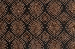 Brown colored patterned fabric texture. Details of the texture and weaving of brown fabric stock photos