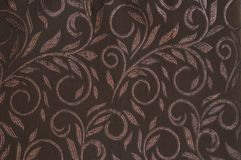 Brown colored patterned fabric texture. Details of the texture and weaving of brown fabric royalty free stock photography