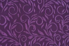 Purple colored patterned fabric texture. Details of the texture and weaving of purple fabric stock photos