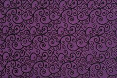 Purple colored patterned fabric texture. Details of the texture and weaving of purple fabric royalty free stock photo