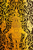 Details of Thai traditional style door painting. Royalty Free Stock Photo