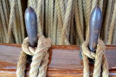 Details of tied rope from boat and wooden tools Stock Photography