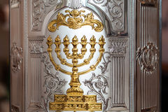 Details of the Torah scroll cover. With the menorah gold image on it Royalty Free Stock Images