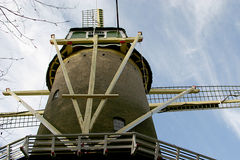 Details of a tower mill. This dutch tower mill has been built in the city of Delft. This mill is so high, because it has to rise far above the houses in the city Stock Images