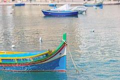 Details of Traditioanl fishermen boat at bay. Old fishermen boat in Spinola bay at Malta Stock Photo