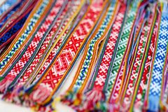 Details of a traditional colorful Lithuanian weave. Woven belts as a part of national Lithuanian costume. Details of a traditional colorful Lithuanian weave Royalty Free Stock Images