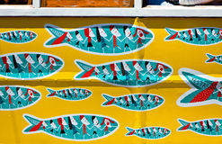 Details of traditional Lisbon yellow tram decorated with sardine Stock Photos