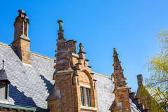 Details of traditional medieval house exterior against blue sky in Brugge, Belguim Royalty Free Stock Photography