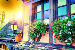 Details of traditional timber frame house. Alsace, France. Details of traditional timber frame house at sunset. Alsace, France royalty free stock images