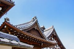 Details Of Traditional Wooden Japanese Temple Roof In area Buddhist temple and Park is identity In Kyoto. Royalty Free Stock Photo