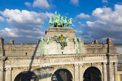 Details of the Triumphal arch with cloudy sky, Brussels Stock Photos