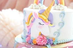 Details of a unicorn cake - Unicorn topper close up. Details of a unicorn cake - Beautiful unicorn topper close up stock image