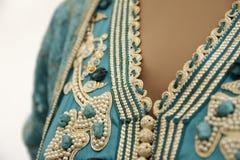 Details van een blauwe Marokkaanse kaftan Stock Foto