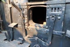 Details van een uitstekende drijfcabine van de stoomtrein Stock Foto's