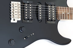 Details van elektrische die gitaar op wit worden geïsoleerd Royalty-vrije Stock Afbeeldingen