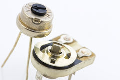 Details of a variable resistors, trimmers. Two precision variable resistors for assembly to the circuit, with a plastic nozzle for easy setup Stock Image