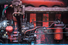 Details of a very old tractor, mechanical parts Stock Photo