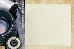 Details of vintage camera equipment, negative films and photos. Top view Royalty Free Stock Photography