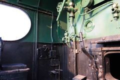Details of a vintage steam train driving cabin. Royalty Free Stock Photo