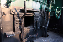 Details of a vintage steam train driving cabin. Stock Photos