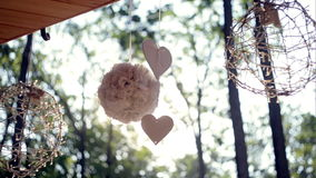 Details Wedding decoration - heart and bouquet of summer flowers spring morning. stock footage