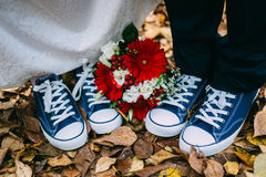 Details wedding rings leaves autumn gumshoes Stock Image