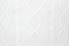 Details of white knitted winter sweater as background. royalty free stock images