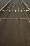 Details of wide street roads with traffic symbols Royalty Free Stock Images