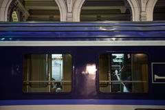 Details on windows of an overnight train ready for departure with people on beds in the interior of the train. Picture of a sleeping car at Budapest keleti train Stock Photos