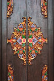 Details of wooden ornate entrance door to temple In Bali. Indone Stock Images