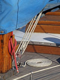 Details of yacht rope around cleat. Details of rope around cleat on wooden yacht Stock Images