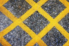 Yellow lines on asphalt texture Royalty Free Stock Photography
