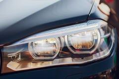 Detailschoonheid en snelle auto met koplamp stock foto's