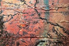 Detalhado perto acima da superf?cie da casca colorida pulverizou a pintura em muros de cimento resistidos foto de stock royalty free
