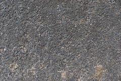 Detalhado perto acima da superf?cie do asfalto em ruas com pedras e quebras pequenas imagem de stock royalty free