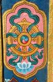 Detalhe arquitectónico de monastério budista - roda do dharma Foto de Stock