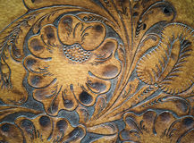 Detalhe cinzelado leatherwork de Brown na sela Fotografia de Stock Royalty Free