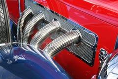 Detalhe clássico das tubulações de exaustão do automóvel fotografia de stock royalty free