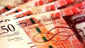 Detalhe de cédulas de 50 libras com a cara da rainha do Reino Unido Fotografia de Stock Royalty Free