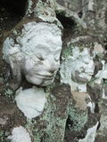 Detalhe de cara da pedra do vintage no templo de Bayon em Angkor Wat Foto de Stock Royalty Free