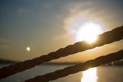 Detalhe de cordas no veleiro com por do sol no fundo Imagem de Stock Royalty Free