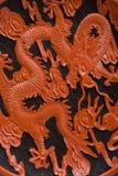 Detalhe de dragão chinês do vermelho da sagacidade do saucer Imagem de Stock
