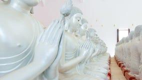 Detalhe de estátuas das Budas que decora o templo budista Fotos de Stock