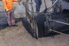 Detalhe de máquina do paver do asfalto foto de stock