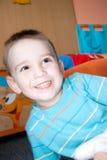 Detalhe de menino da cara em casa Fotos de Stock Royalty Free
