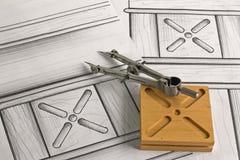 Detalhe de mobília com projeto e compasso Fotos de Stock