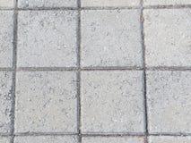 Detalhe de pavimentar blocos de cimento quadrado fotos de stock