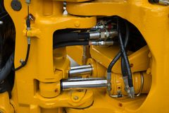 Detalhe de pistão hidráulico novo da escavadora Imagens de Stock Royalty Free