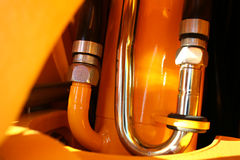 Detalhe de sistema hidráulico de um trator imagens de stock royalty free